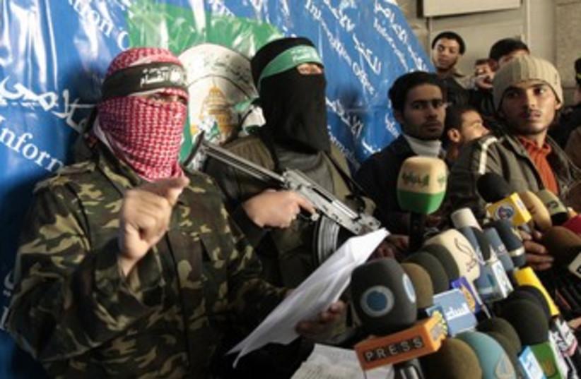 Masked Hamas men hold a press conference 370 (R) (photo credit: Mohammed Salem / Reuters)