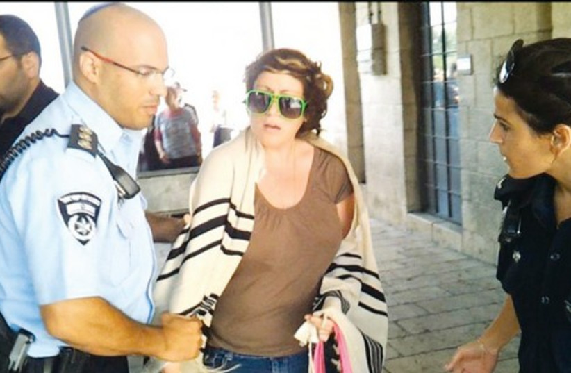 Police officer detains Deborah Houben at Western Wall Plaza  (photo credit: Women of the Wall)