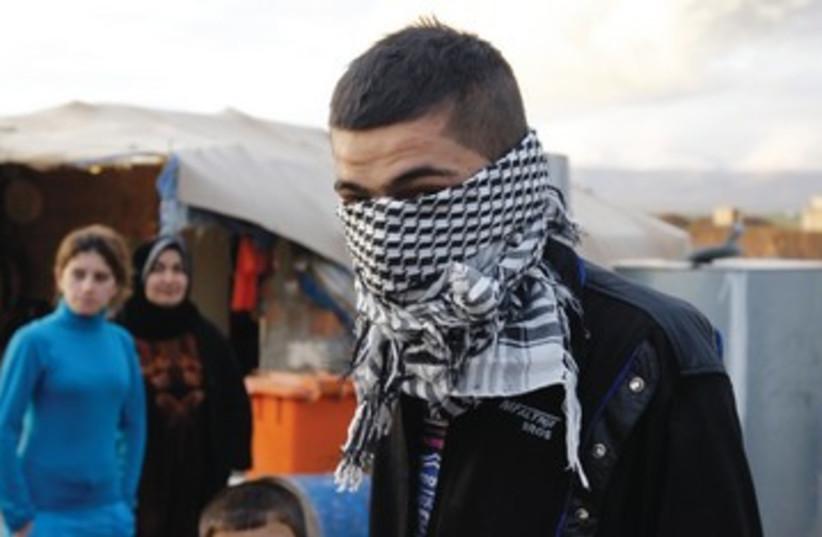 A Syrian Kurd refugee in Iraq 390 (photo credit: Azad Lashkari/Reuters)