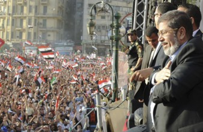 Egypt's Mohamed Mursi at Tahrir Square rally 370 (R) (photo credit: REUTERS / Handout)