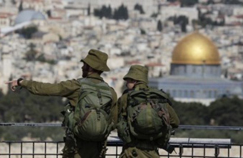 IDF soldiers view Old City of J'lem from Mt. of Olives 37 (photo credit: Darren Whiteside / Reuters)