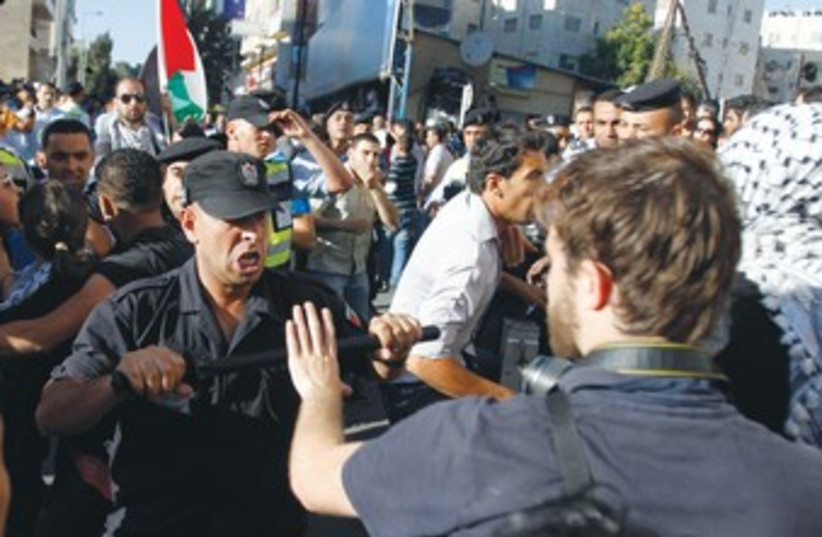 Palestinian security confronts journalist in Ramallah 370 (photo credit: REUTERS)