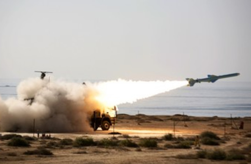 An Iranian Qader long-range missile is fired 370 (R) (photo credit: Reuters/Handout)