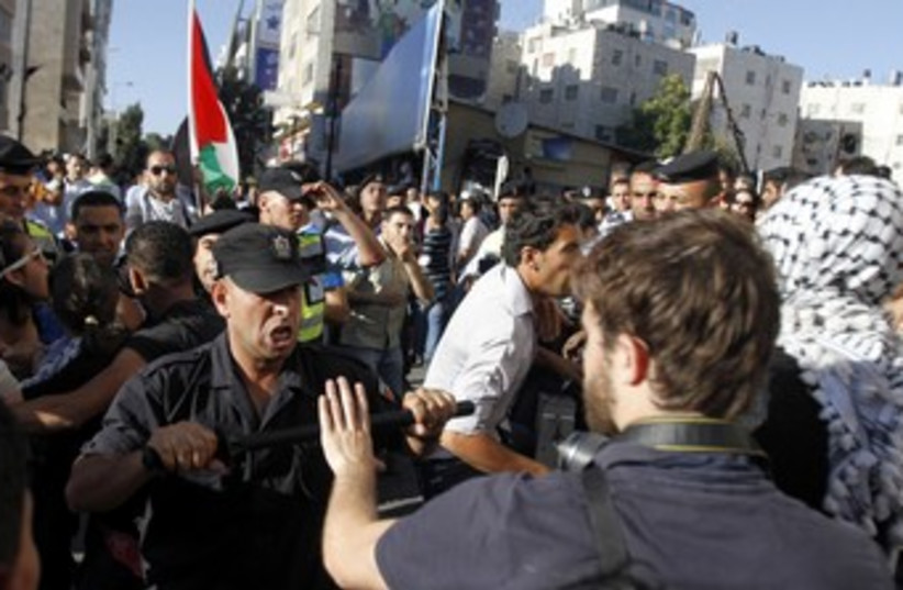PA security forces scuffle with protesters in Ramallah 370 (photo credit: REUTERS)