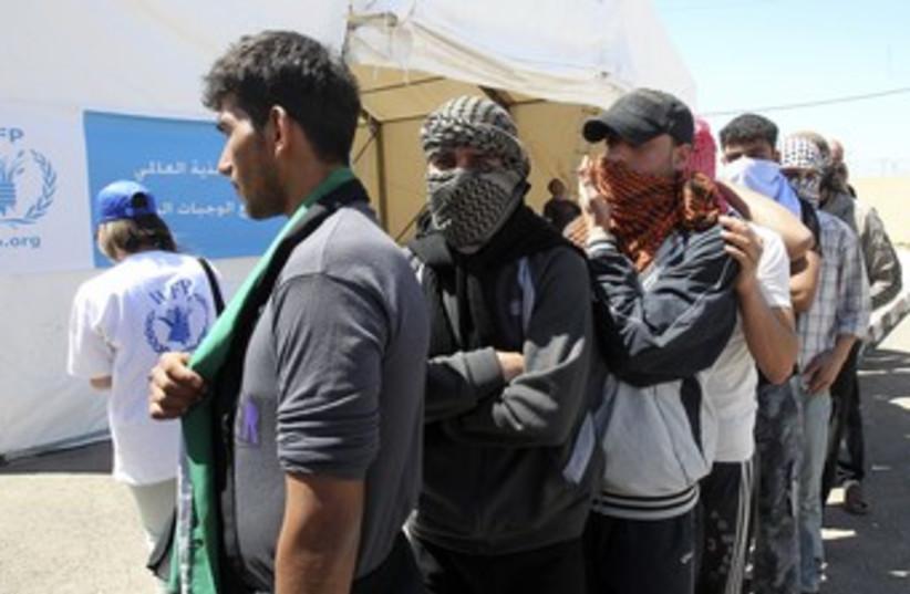 Syrian refugees in Jordan 370 (photo credit: REUTERS)