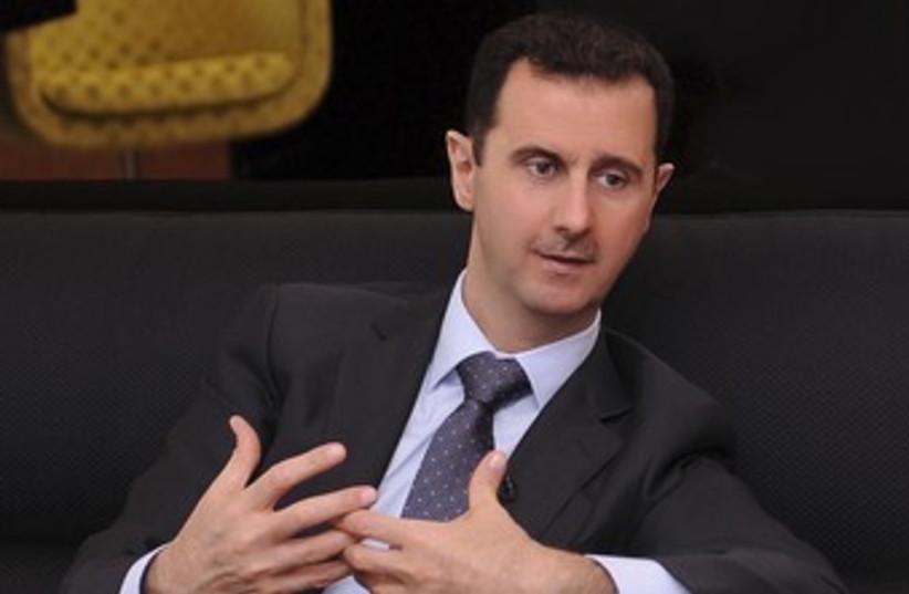 Syrian President Bashar Assad 370 (R) (photo credit: Sana / Reuters)