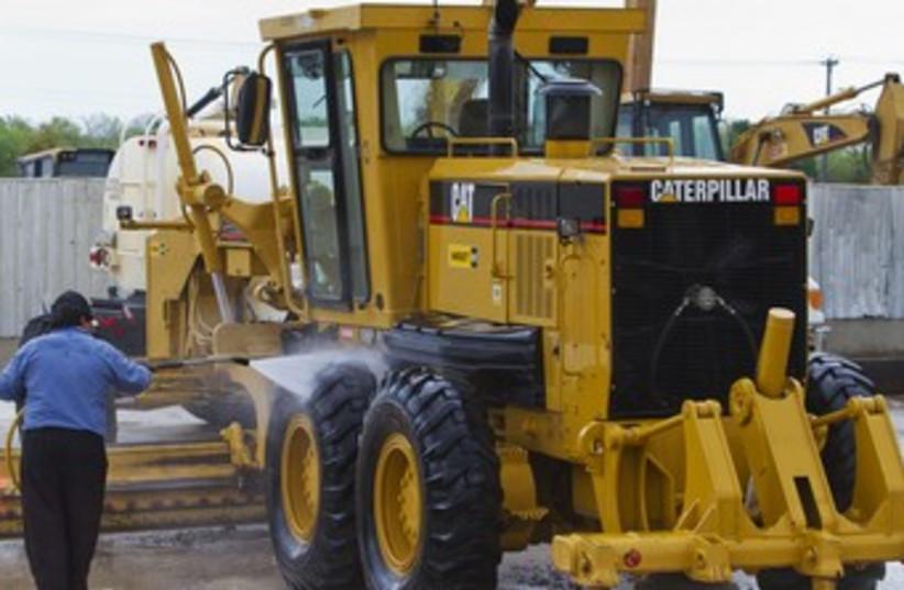 Caterpillar road grader 370 (photo credit: REUTERS)