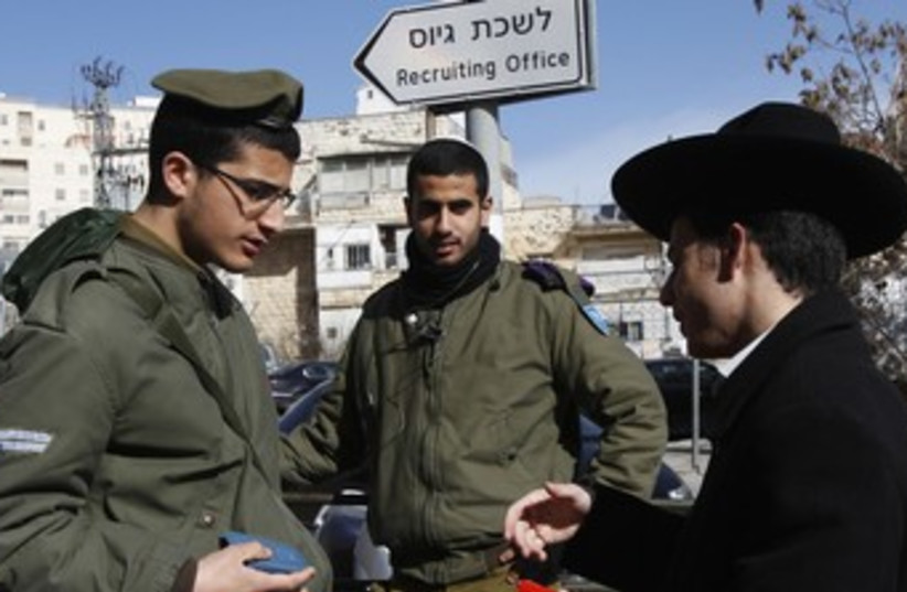 Haredi with IDF soldiers 370 (photo credit: REUTERS/Baz Ratner)