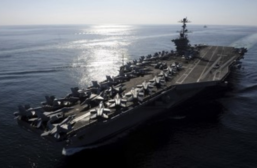 US Naval aircraft carrier in Strait of Hormuz 370 (photo credit: REUTERS)