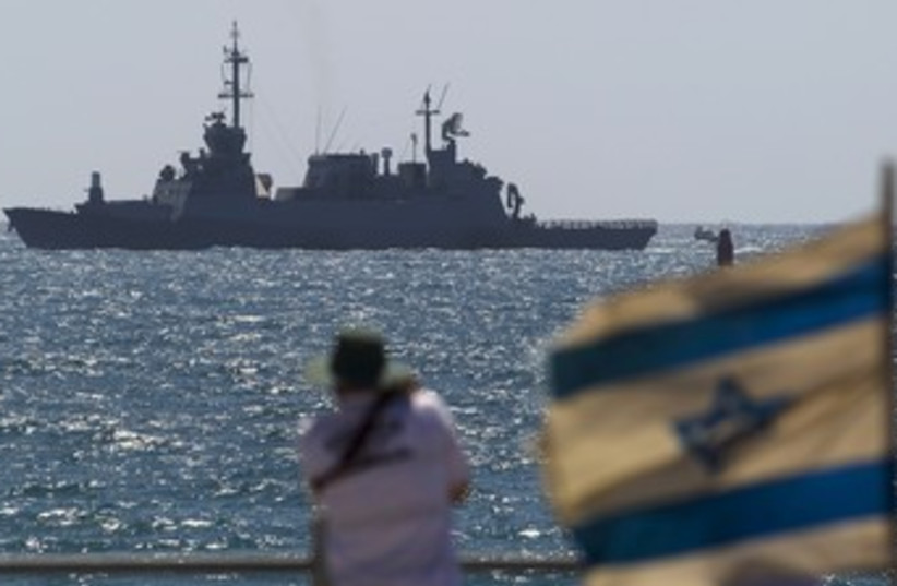 Man looks at Israeli Navy boat off Ashdod 370 (photo credit: Amir Cohen / Reuters)