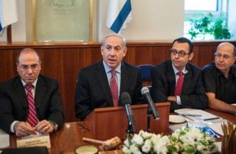 Prime Minister Binyamin Netanyahu at cabinet meeting 370  (photo credit: Pool / Flash 90)