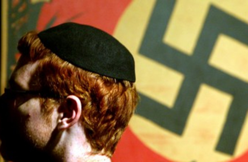 Jewish man in front of swastika 370 (photo credit: REUTERS)