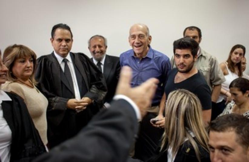 Ehud Olmert rejoices following court verdict 370 (photo credit: Emile Solomon/ Haaretz)