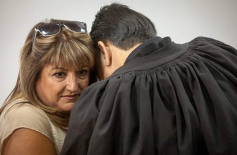 Shaula Zaken embraces lawyer 370 (photo credit: Emile Solomon/ Haaretz)