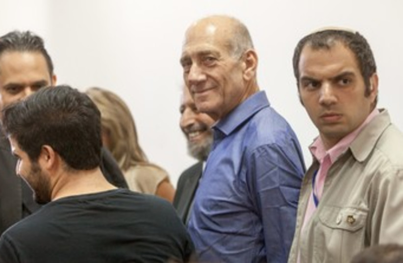 Former PM Ehud Olmert after verdict 370 (photo credit: Emil Salman/ Pool)