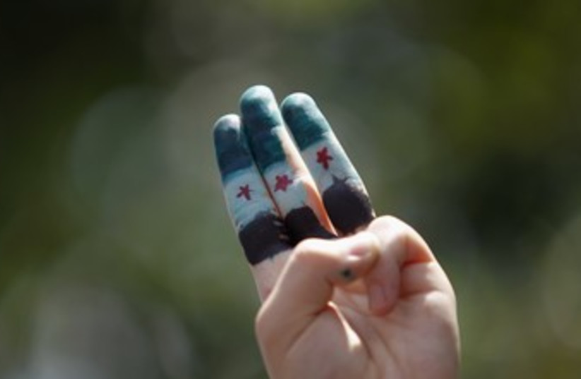 Syrian independence flag painted on fingers 370 (photo credit:  REUTERS/Bazuki Muhammad)