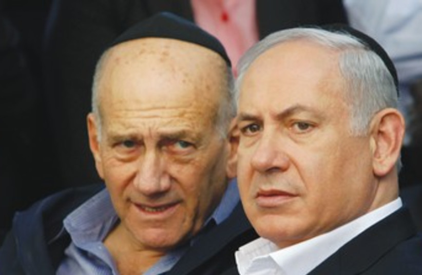 Olmert, Netanyahu 370 (photo credit: Moti Milrod/Haaretz/Reuters)