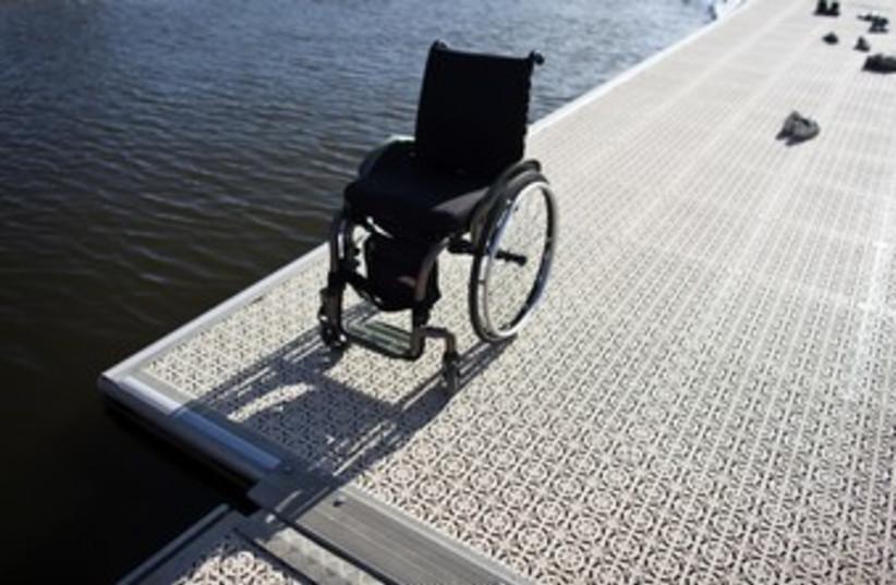 A wheelchair at Tel Aviv's Yarkon River 370 (photo credit: NIR ELIAS / Reuters)