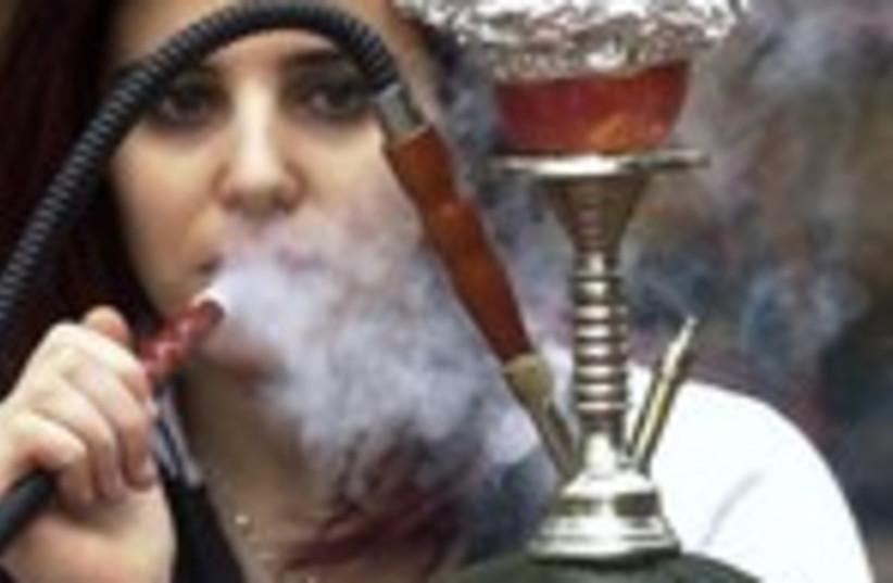 Woman smokes nargila from a hookah 150 (photo credit: REUTERS/Sharif Karim)