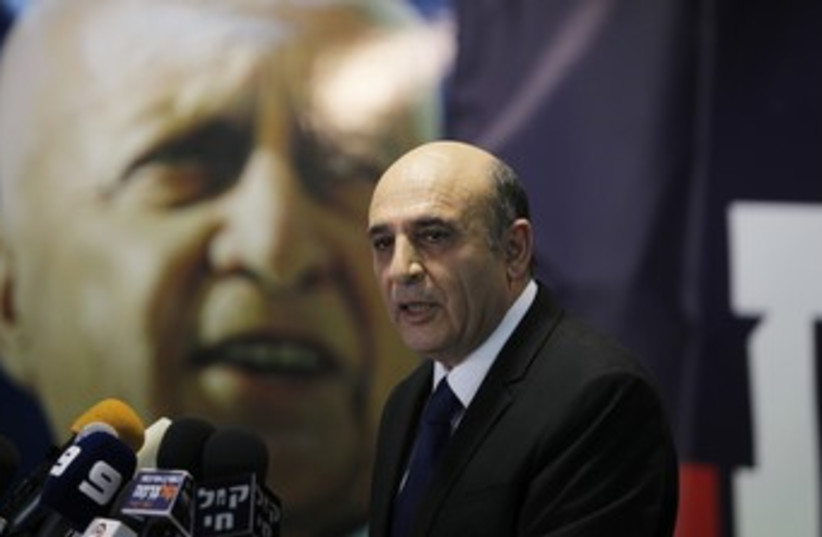 Shaul Mofaz announces Kadima is leaving the gov't 370 R (photo credit: Baz Ratner / Reuters)