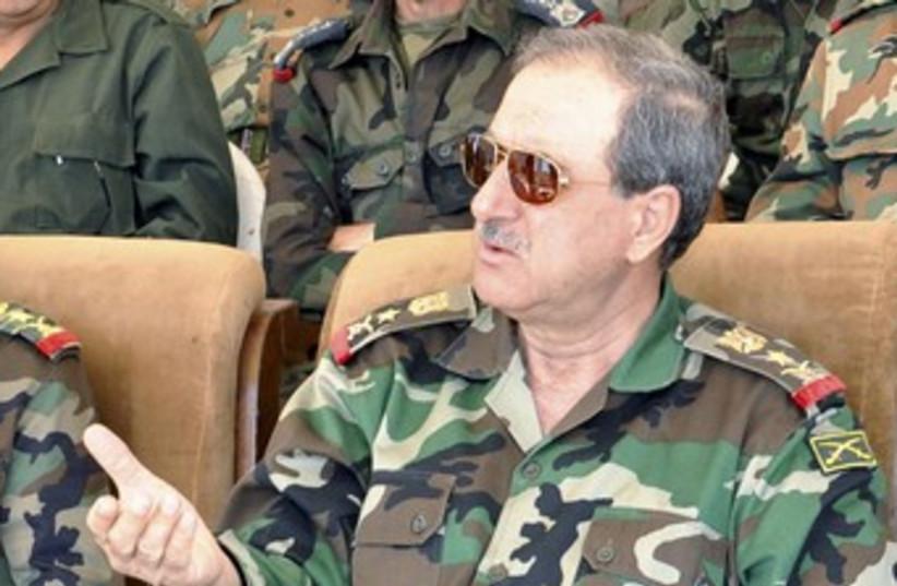 Syrian Defense Minister Daoud Rajha (R) 370 (photo credit: Sana / Reuters)