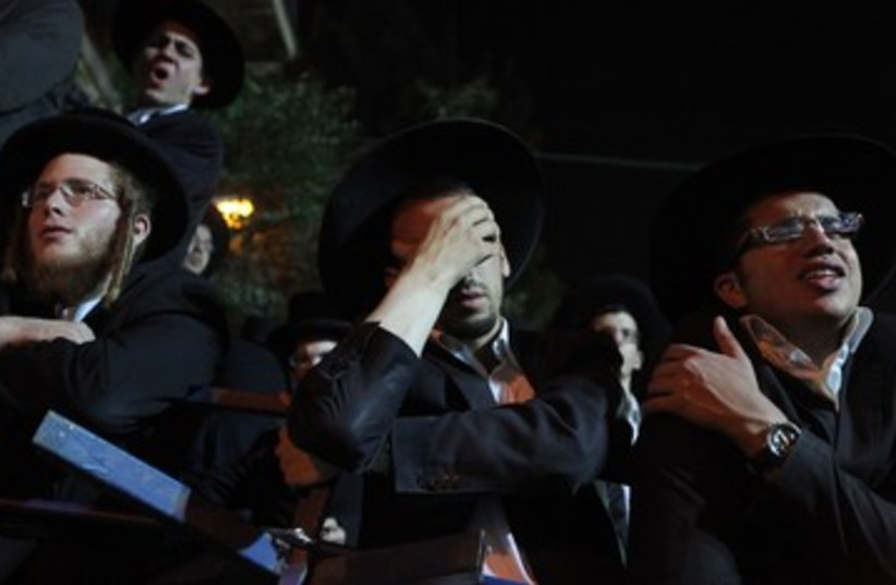 A haredi man overcome with grief (photo credit: Marc Israel Sellem/The Jerusalem Post)