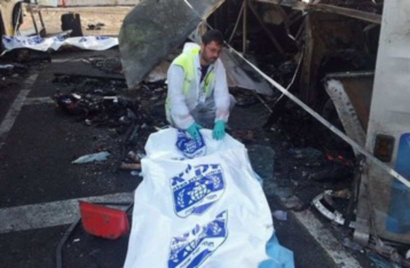 ZAKA worker at site of bombing 390 (photo credit: Avigdor Shatran)