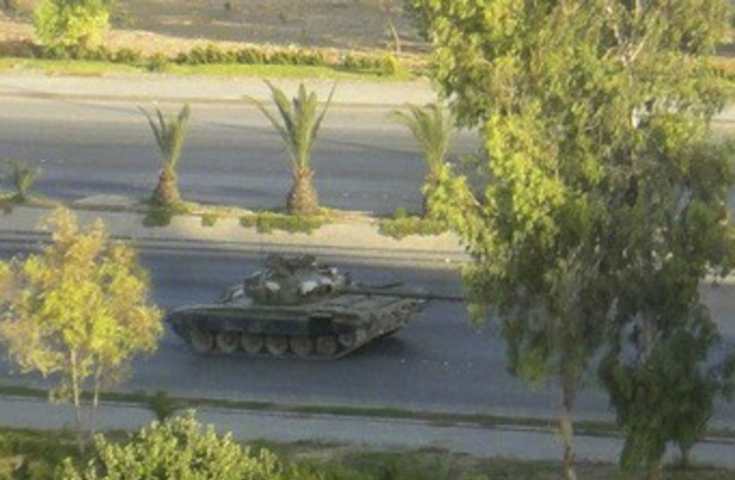 Syrian tank is seen in Damascus 370 (photo credit: REUTERS / Handout)