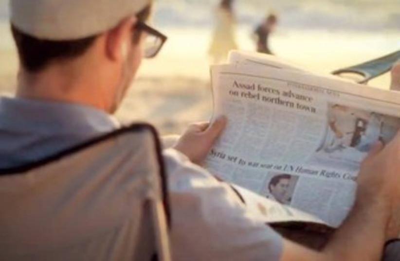 MAN reads a copy of 'The Jerusalem Post' (photo credit: YouTube screenshot)