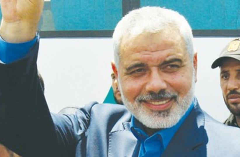 Hamas's Haniyeh enters Egypt through Rafah 370 (photo credit: Ibraheem Abu Mustafa/Reuters)
