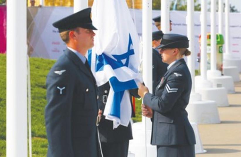 Israeli flag raised at London's Olympic Village 390 (photo credit: Mark Blinch/Reuters)