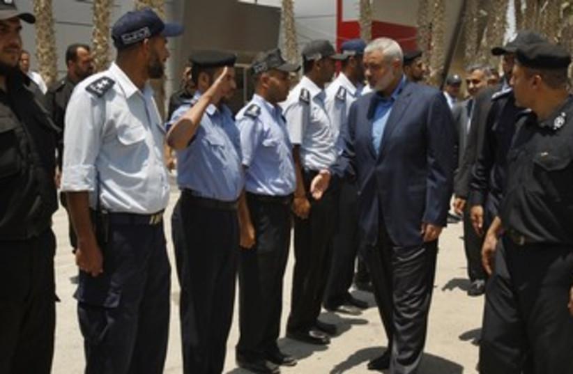Hamas PM Haniyeh at Rafah before entering Egypt 370 (photo credit: REUTERS/Ibraheem Abu Mustafa)
