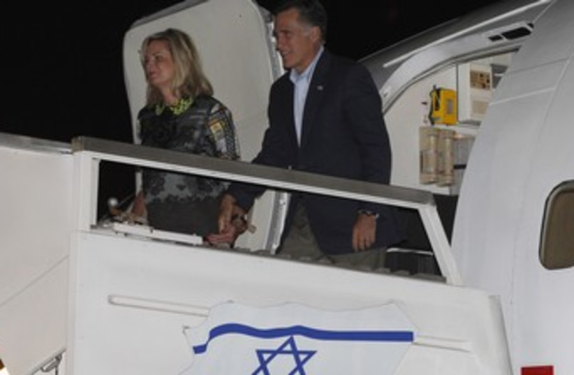 Romney and wife exit plane in Israel 370 (photo credit: Reuters)