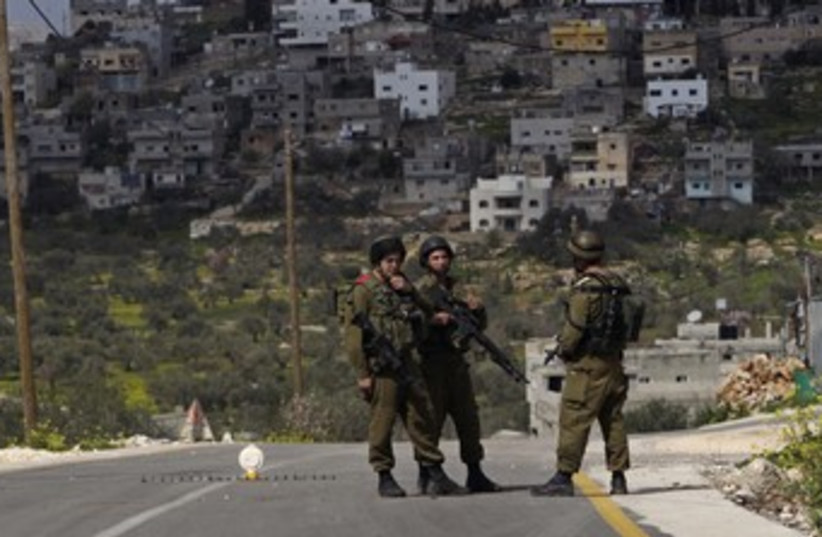 IDF soldiers at West Bank checkpoint 370 (photo credit: REUTERS/Ammar Awad)