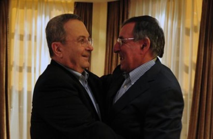 Ehud Barak Leon Panetta hug 390 (photo credit: Ariel Harmoni / GPO)