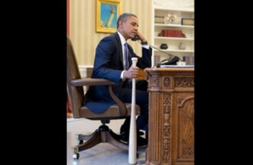 Obama holds baseball bat 370 (photo credit: White House)