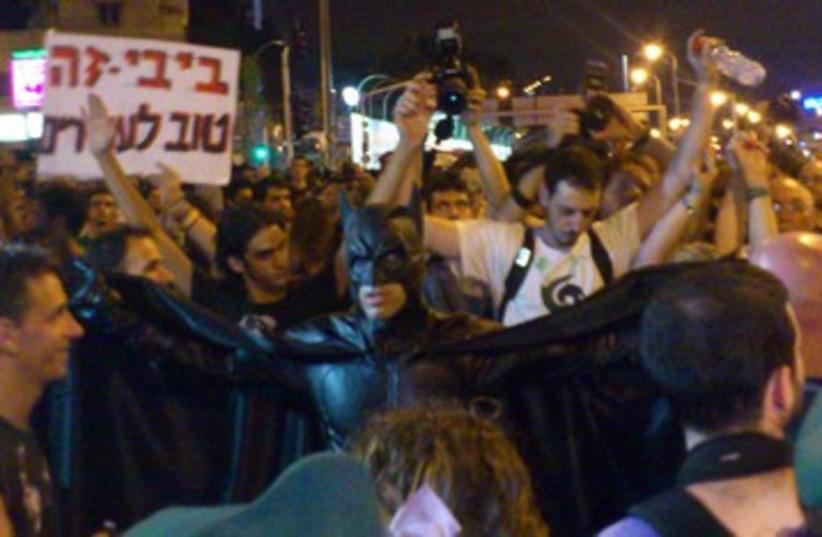 Man dressed as Batman at Tel Aviv protest