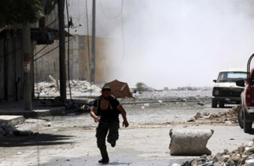 Syria fighting 370 (photo credit: Goran Tomasevic / Reuters)