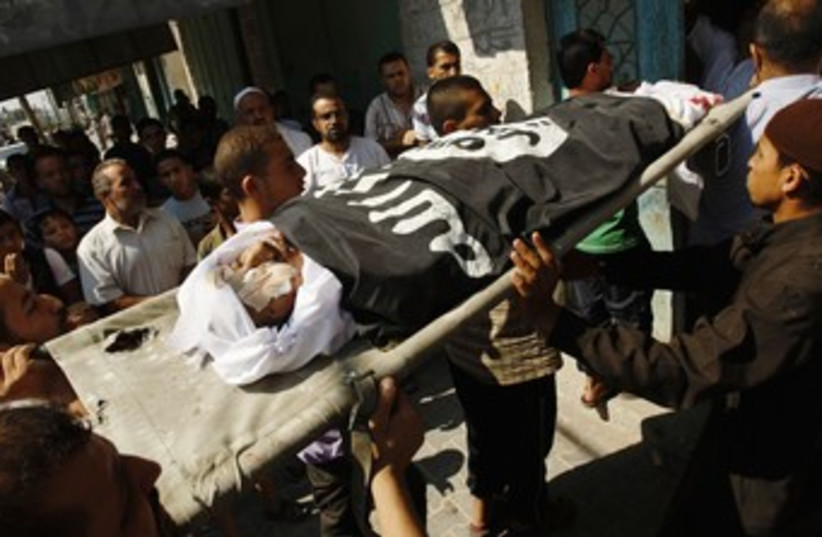 Body of Eid Hjazi (photo credit: REUTERS/Ibraheem Abu Mustafa)