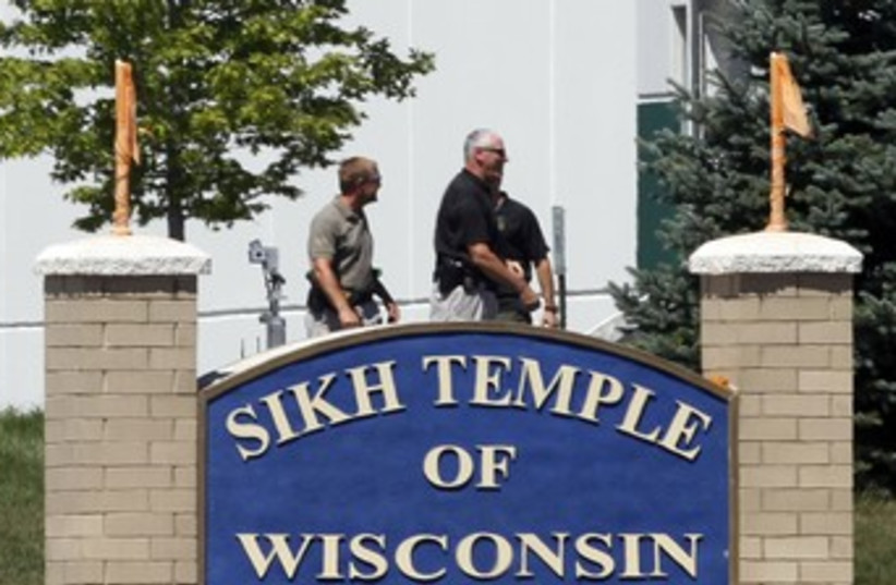 Officials gather near Wisconsin Sikh Temple 370 (photo credit: REUTERS/Allen Fredrickson)