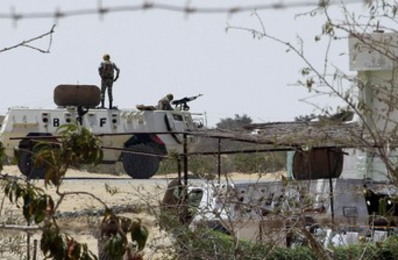 Egyptian soldiers stand guard at a checkpoint in Rafah city  (photo credit: REUTERS)