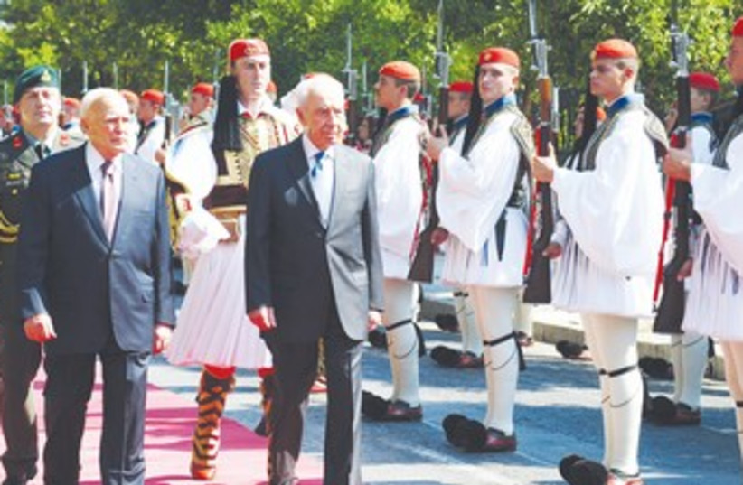 Peres with Greek President Papoulias in Athens 370 (photo credit: Moshe Milner/GPO)