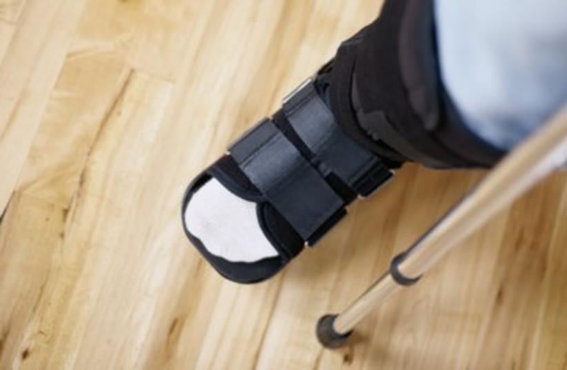 cast limp broken leg crutch injured disabled 390 (photo credit: Thinkstock)