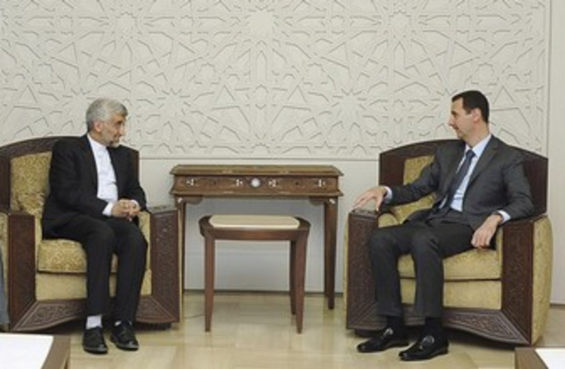 Syria's Assad meets Iran's Jalili 370 (photo credit: REUTERS/Sana Sana)