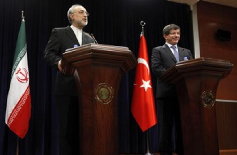 Iran FM Salehi with Turkish counterpart Salehi 370 (photo credit: REUTERS/Umit Bektas)
