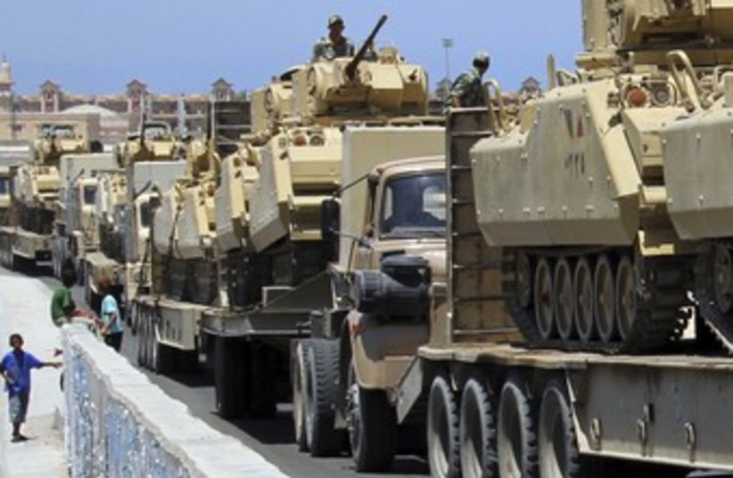 Egyptian tanks arriving in Sinai city of Rafah 370 (R) (photo credit: Mohamed Abd El Ghany / Reuters)