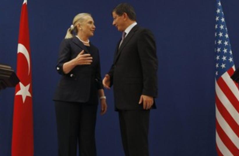 Clinton and Davutoglu (R370) (photo credit: REUTERS/Osman Orsal)