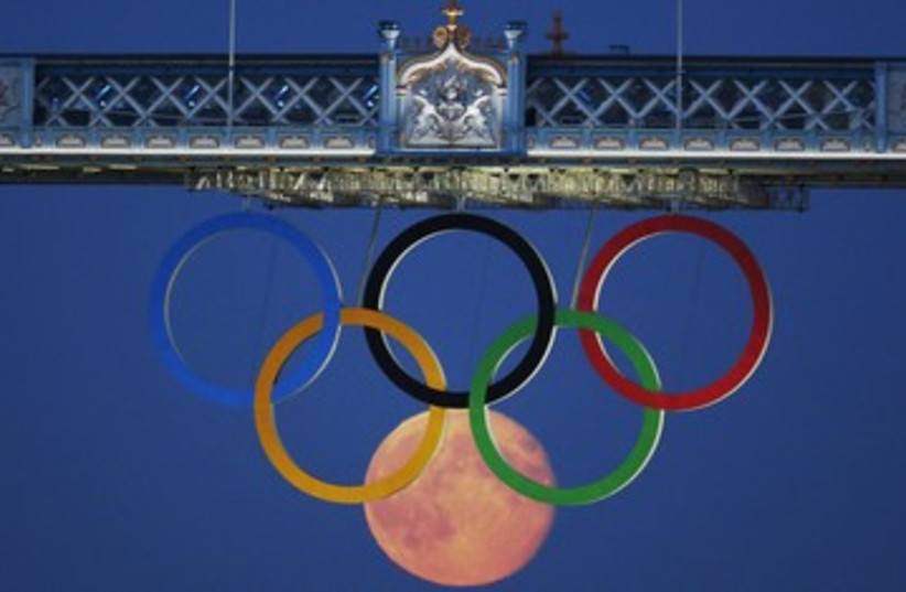Olympic Rings with moon London 2012 390 (photo credit: Luke MacGregor / Reuters)