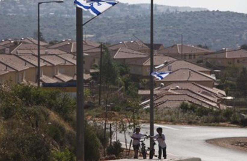 Jewish boys in the West Bank's Bruchin 370 (photo credit: REUTERS/NIR ELIAS)