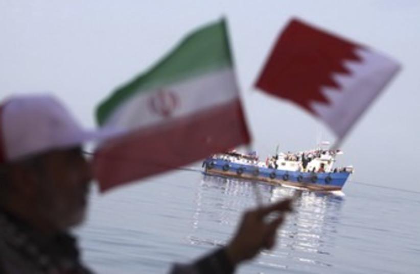 Iranian waves Iran and Bahrain flags 370 (photo credit: REUTERS/Handout .)